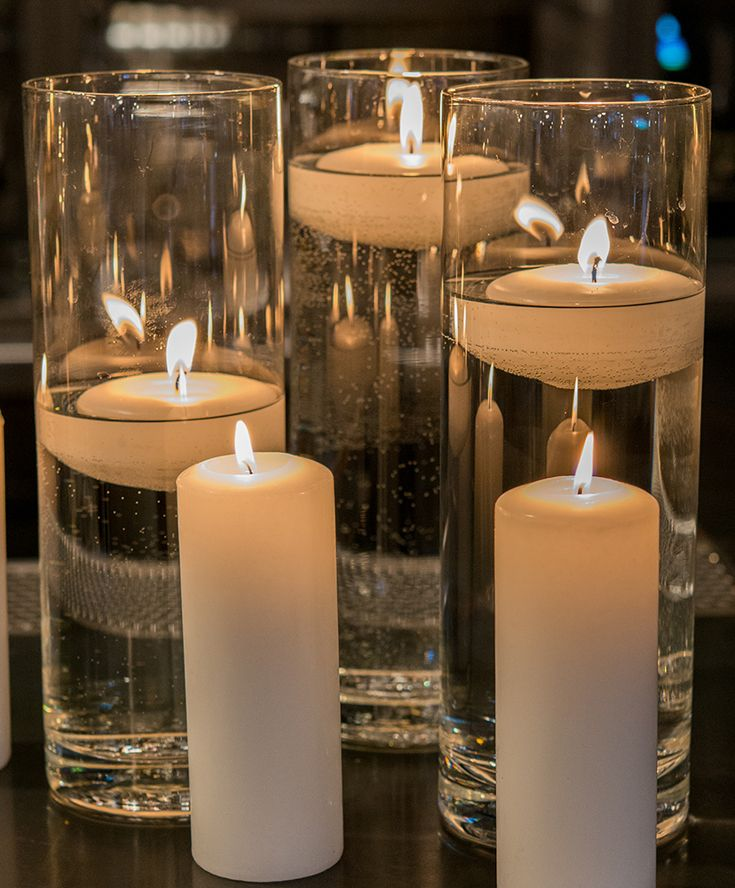 Pair Pillar Candles With Glass Vases At Your Wedding Reception For Romantic Table Decorations