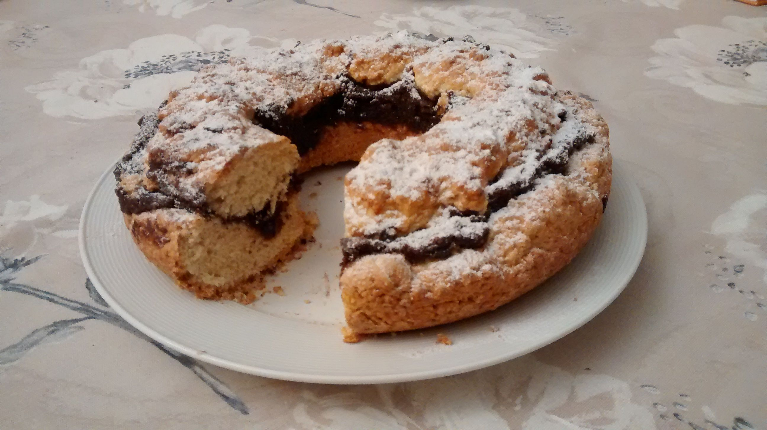 "Ciambella pronounced ""chumbella"" is a traditional rustic Italian cake of a"