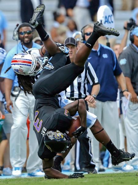 East Carolina's Lance Ray is upended by North Carolina's Tre Boston following a pass reception in Chapel Hill Saturday. (Gerry Broome/AP)
