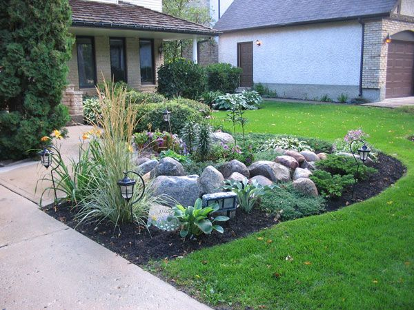 Classic flower bed landscaping with large stones for Large landscaping stones