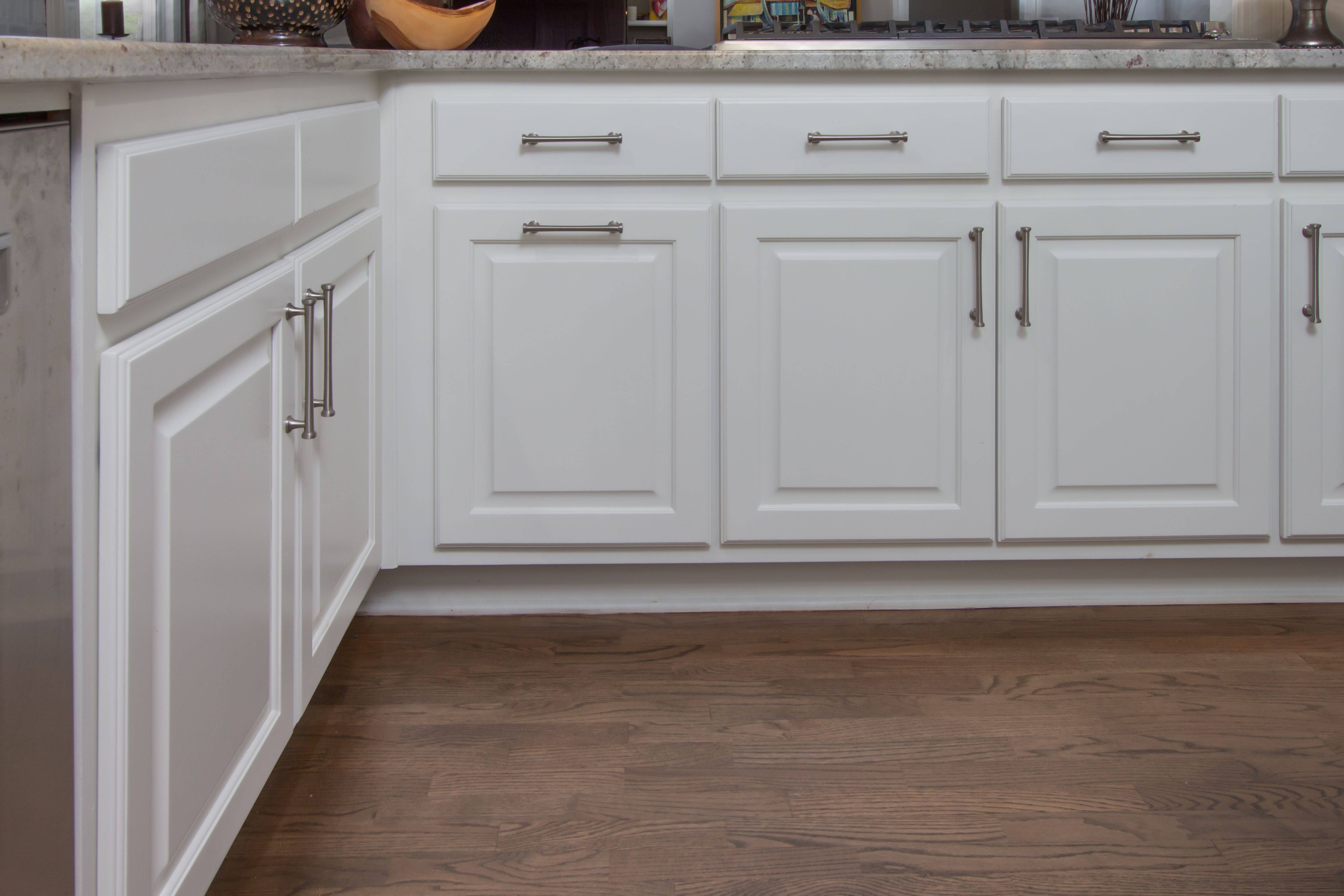 Bright White Raised Panel Cabinets With Brush Nickel Cabinet Handles From Atlas Hardware Raised Panel Cabinets Paint Cabinets White Kitchen Inspirations