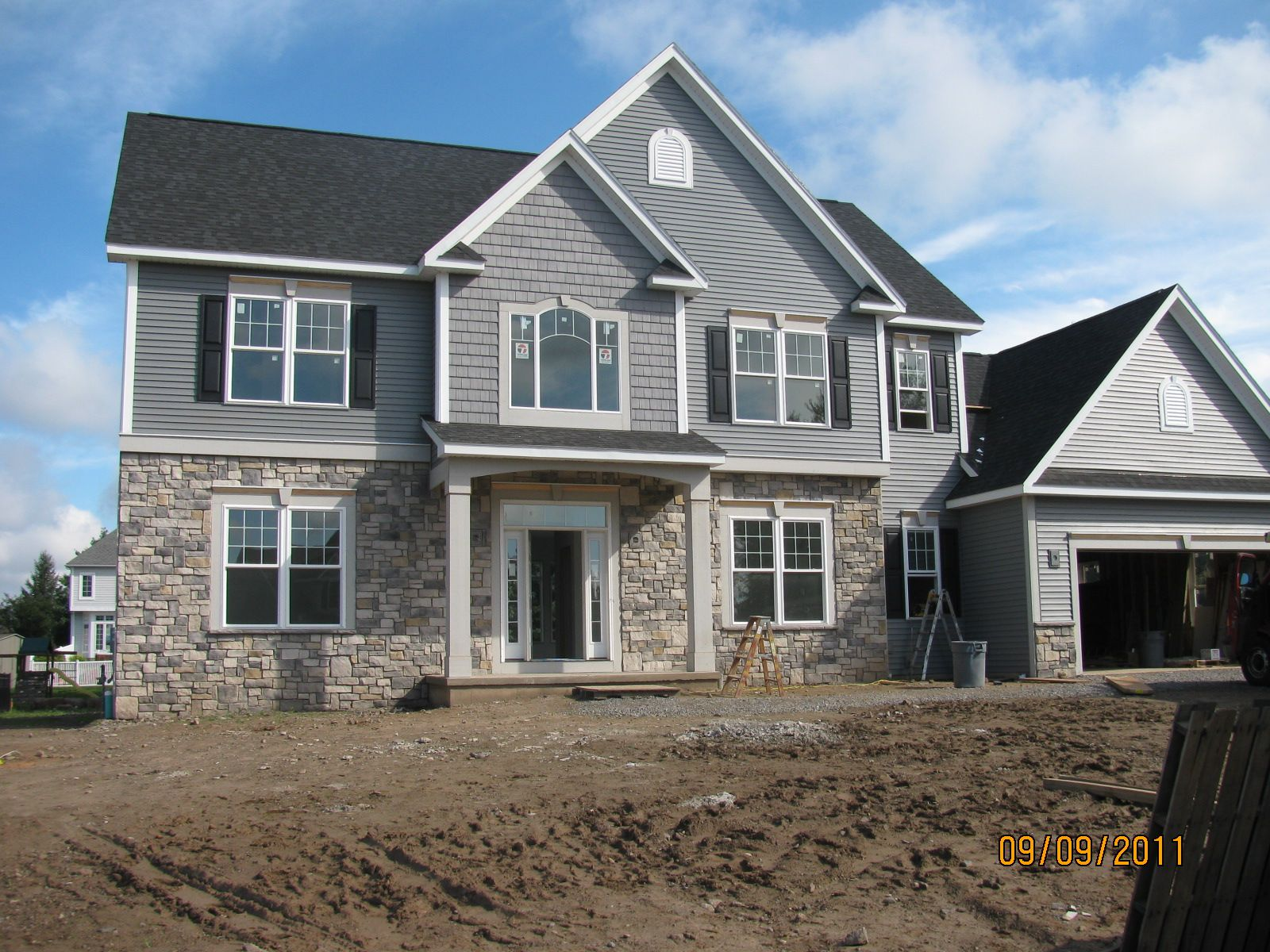 Stone Exterior Accents Colonial House Exteriors Stone Front House Gray House Exterior