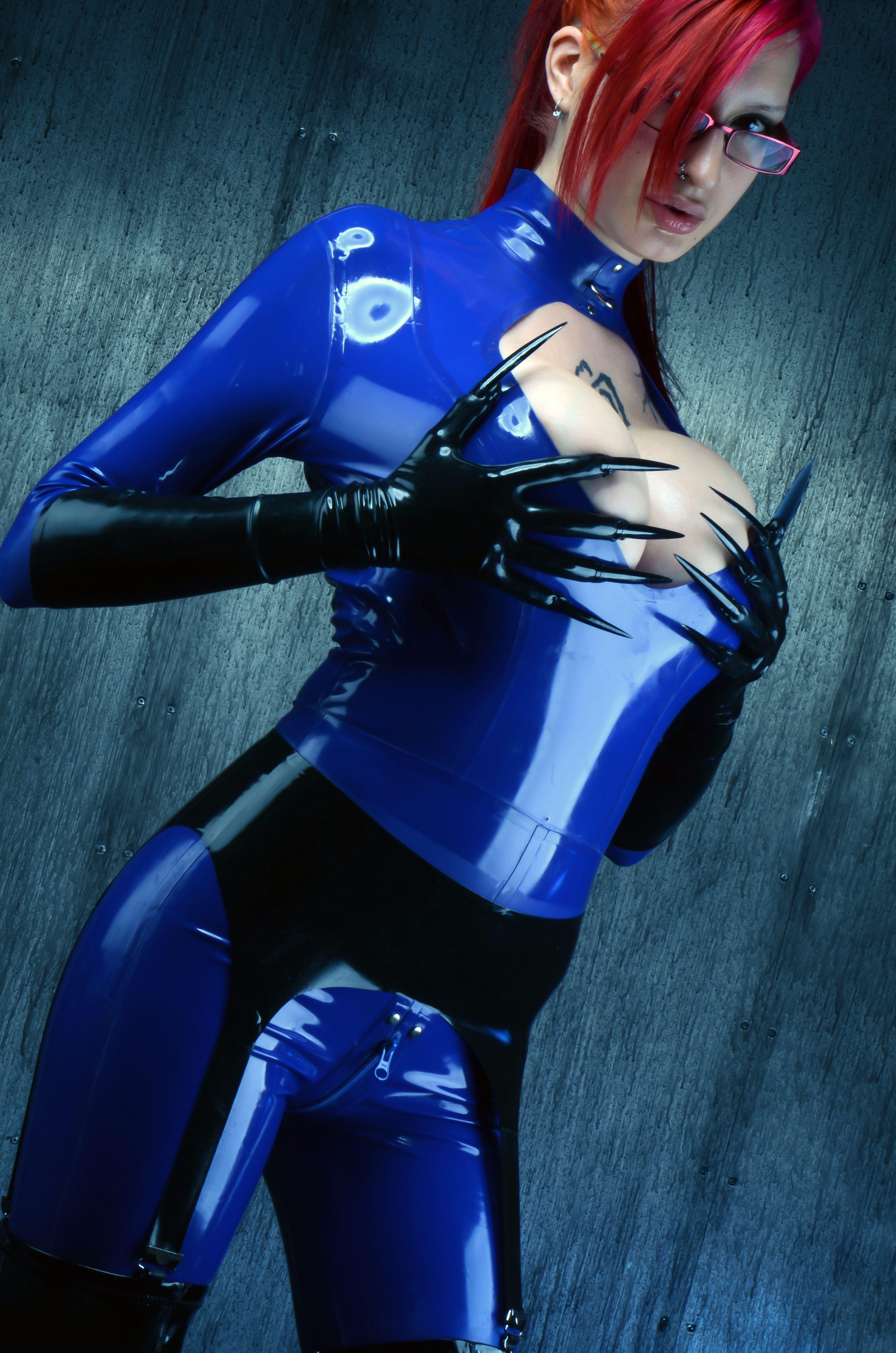 Redhead in blue latex