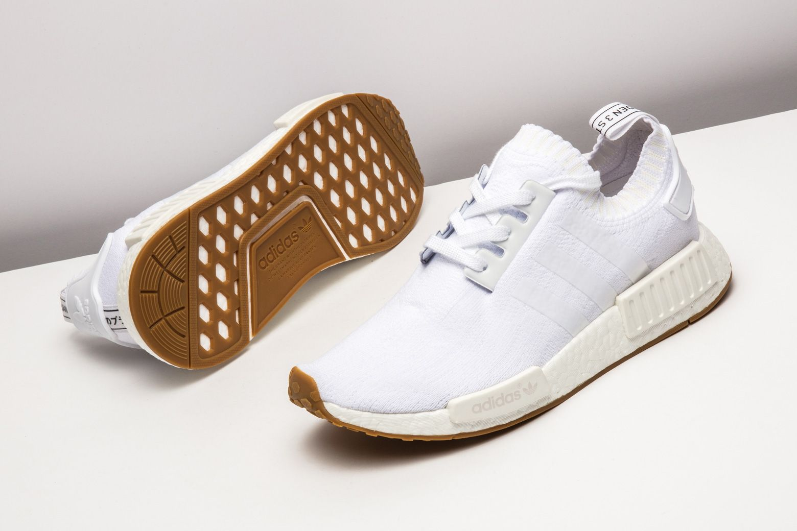 5f440c24bc806 adidas keeps it clean with a pristine white upper and gum sole on this NMD  Primeknit
