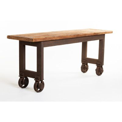 Console table like this on wheels that can roll over my bed as a