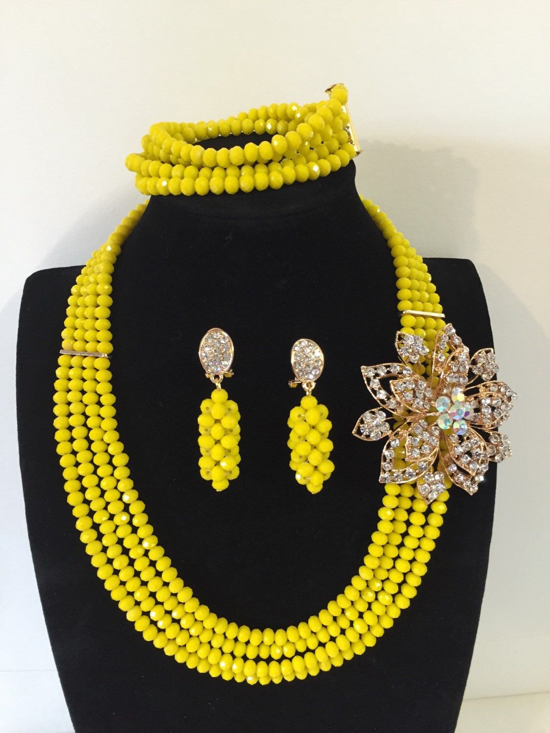 A personal favourite from my Etsy shop https://www.etsy.com/uk/listing/269066666/4-layer-african-nigerian-crystal-beads