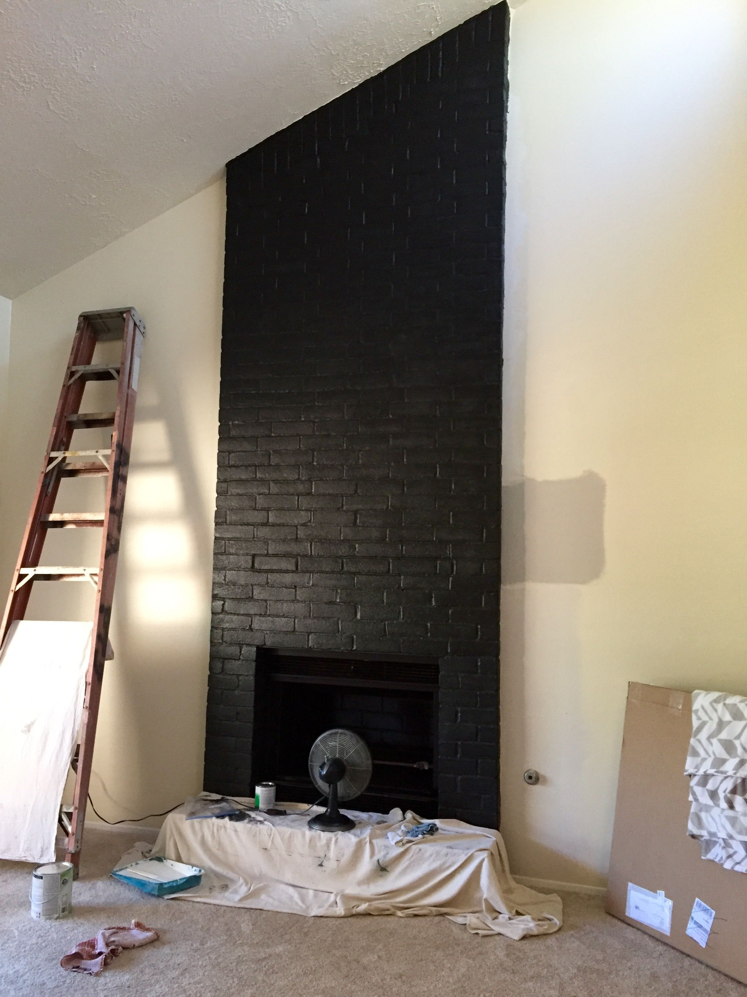 satin black paint enlivens this brick fireplace first home
