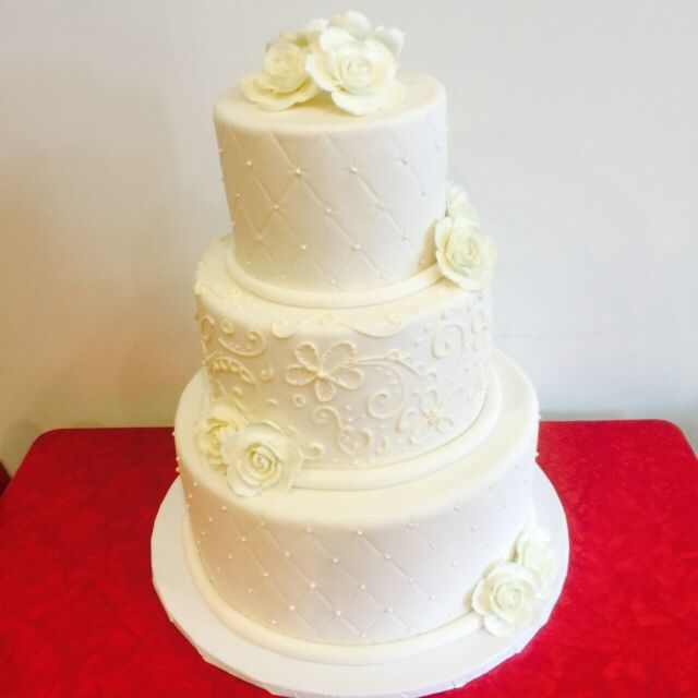 All white buttercream with fondant flowers. Simple and pretty ...