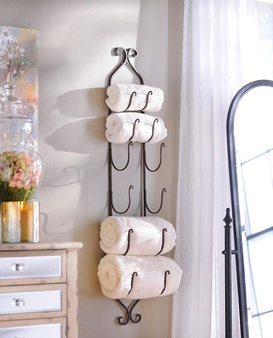 14 Small Space Hacks To Make The Most Of Your Tiny Bathroom Small Bathroom Storage Bathroom Towel Storage Tiny Bathrooms