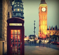 London - Just bought this photo in black and white, with the phone booth RED! It's hanging up in my hall as we speak. Love it to pieces!
