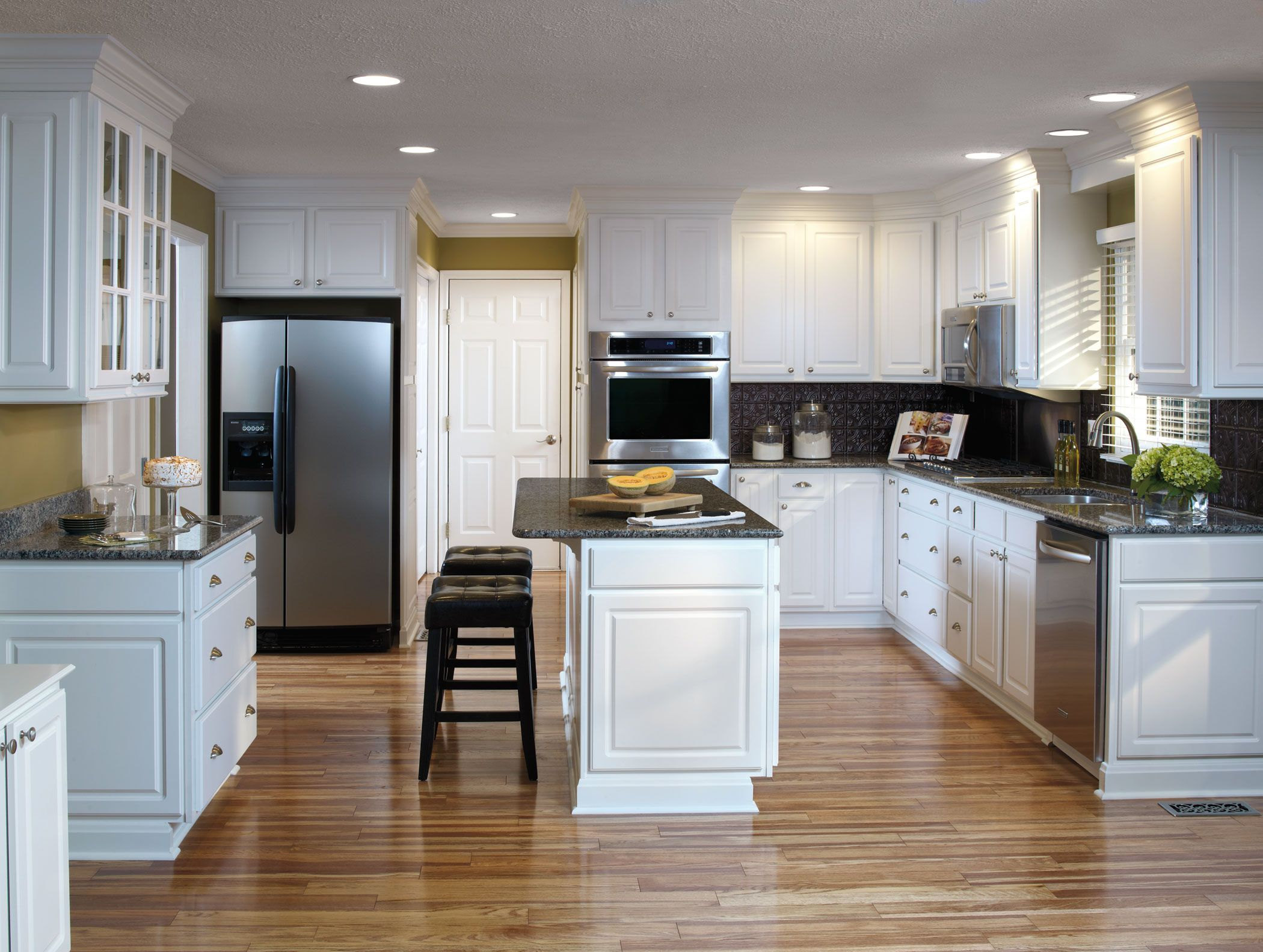 Versatile looks and easy care durability meet in for Easy to clean kitchen cabinets