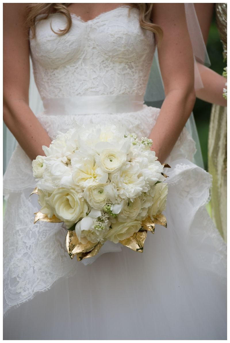 gold white wedding dress Loved the gold leafed magnolia foliage to accent this all white bridal bouquet