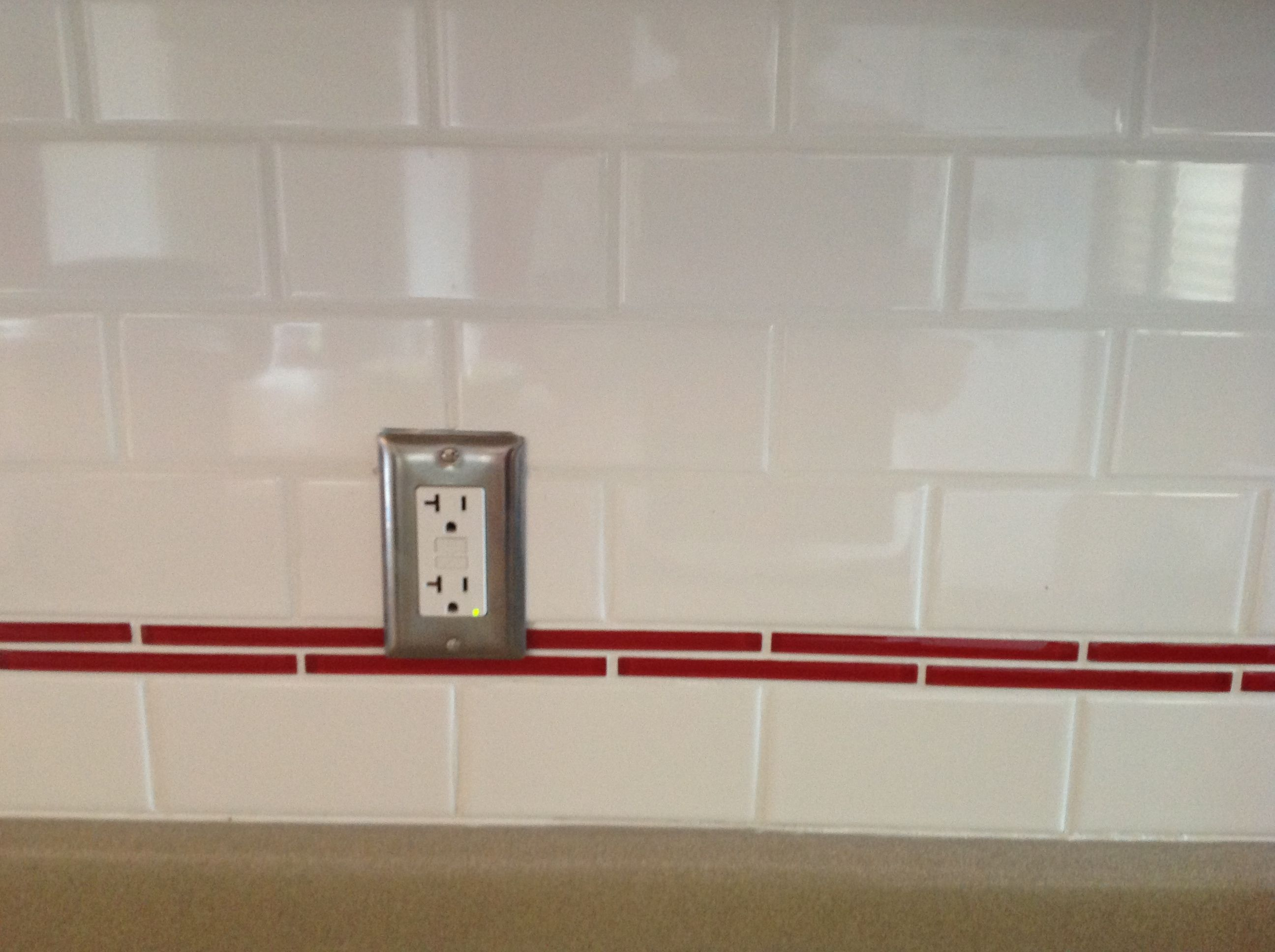 Subway tile backsplash with red liner accent! Done and ...