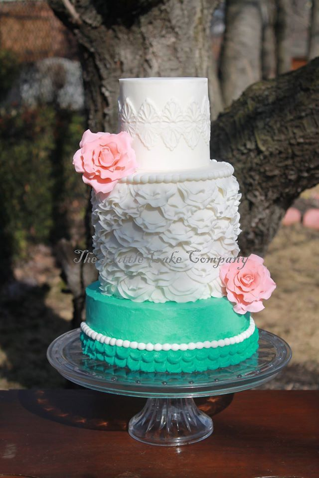Turquoise and white cake created by The Little Cake Company