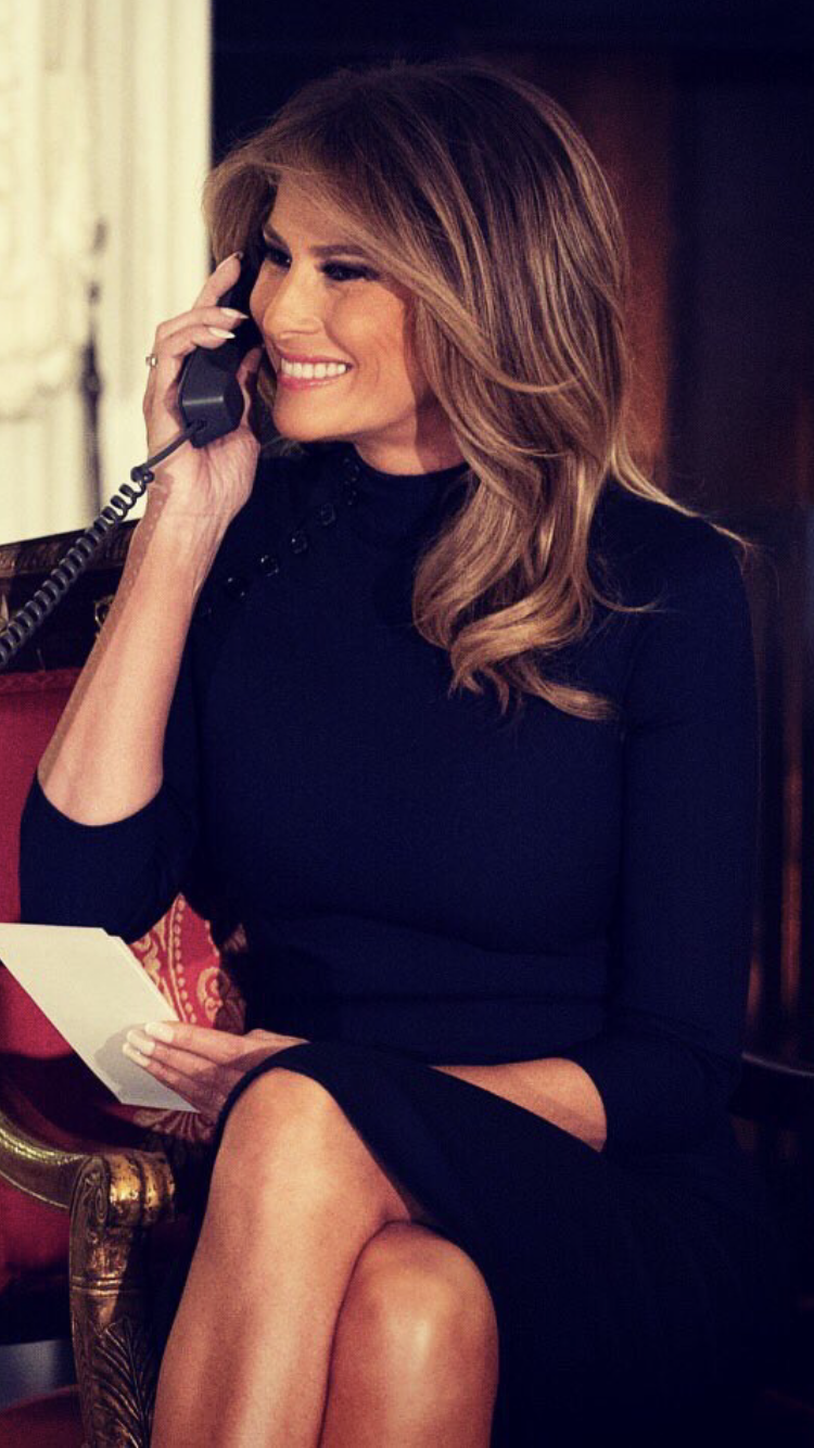 First Lady Melania Trump talking to a child on Christmas Eve 2018
