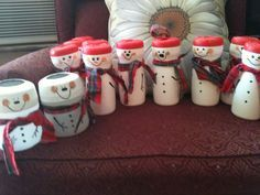 Snow men made from coffee creamer containers . Use to put battery tea lite in, fill with goodies or milk and a straw for Santa! #tidepodscontainercrafts