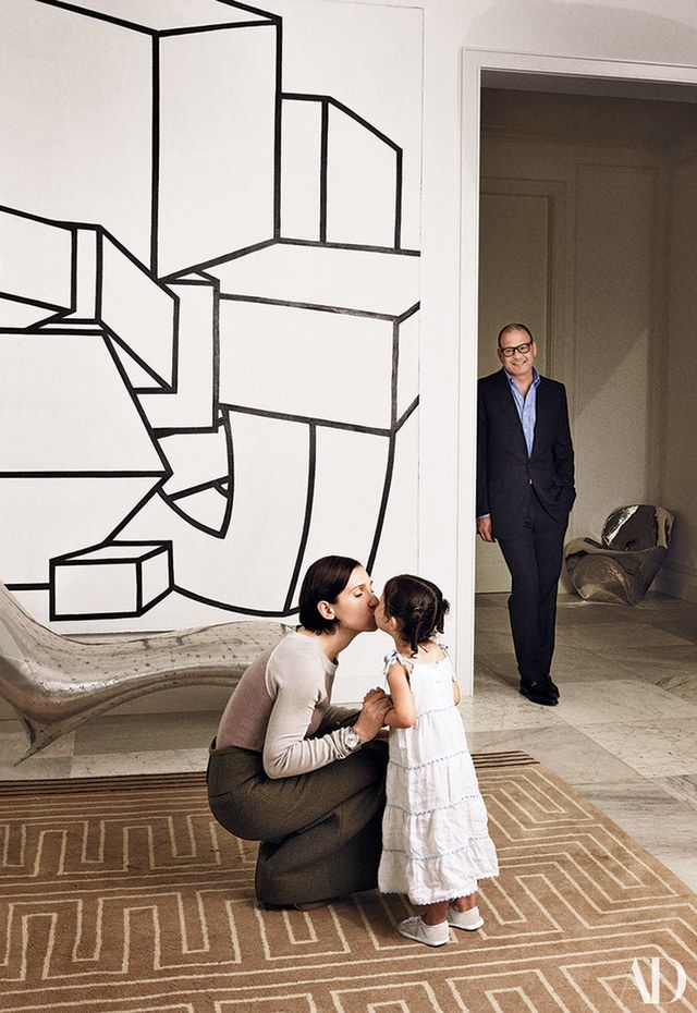Reed, Delphine, and daughter Lily at home in Manhattan (Vogue, 2010). Al Held painting; Lockheed lounge by Marc Newson. | archdigest.com