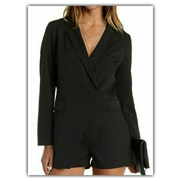 Long Sleeved Blazer Romper Black  The menswear trend is a longtime fave, but this playful romper takes the cake! Thick woven fabric sculpts a long sleeve blazer with notched lapels that sweep into two hidden snap buttons at the waist, adding wrap appeal atop the stylish, attached shorts below. Flap pockets add handy storage along the waistline.   Fully lined in satin Charlotte Russe Pants Jumpsuits & Rompers