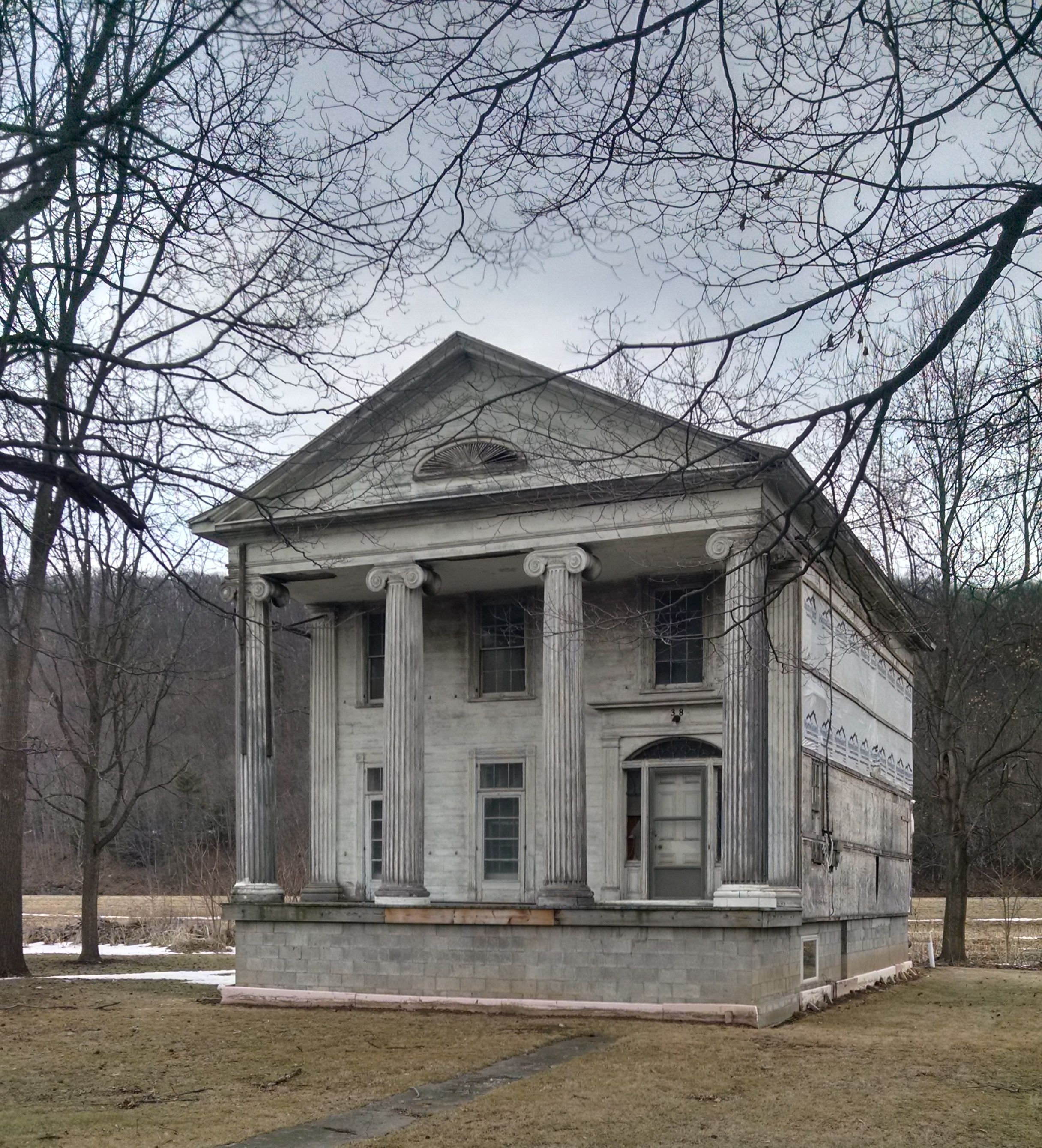 this greek revival home once had two symetrical wings on either