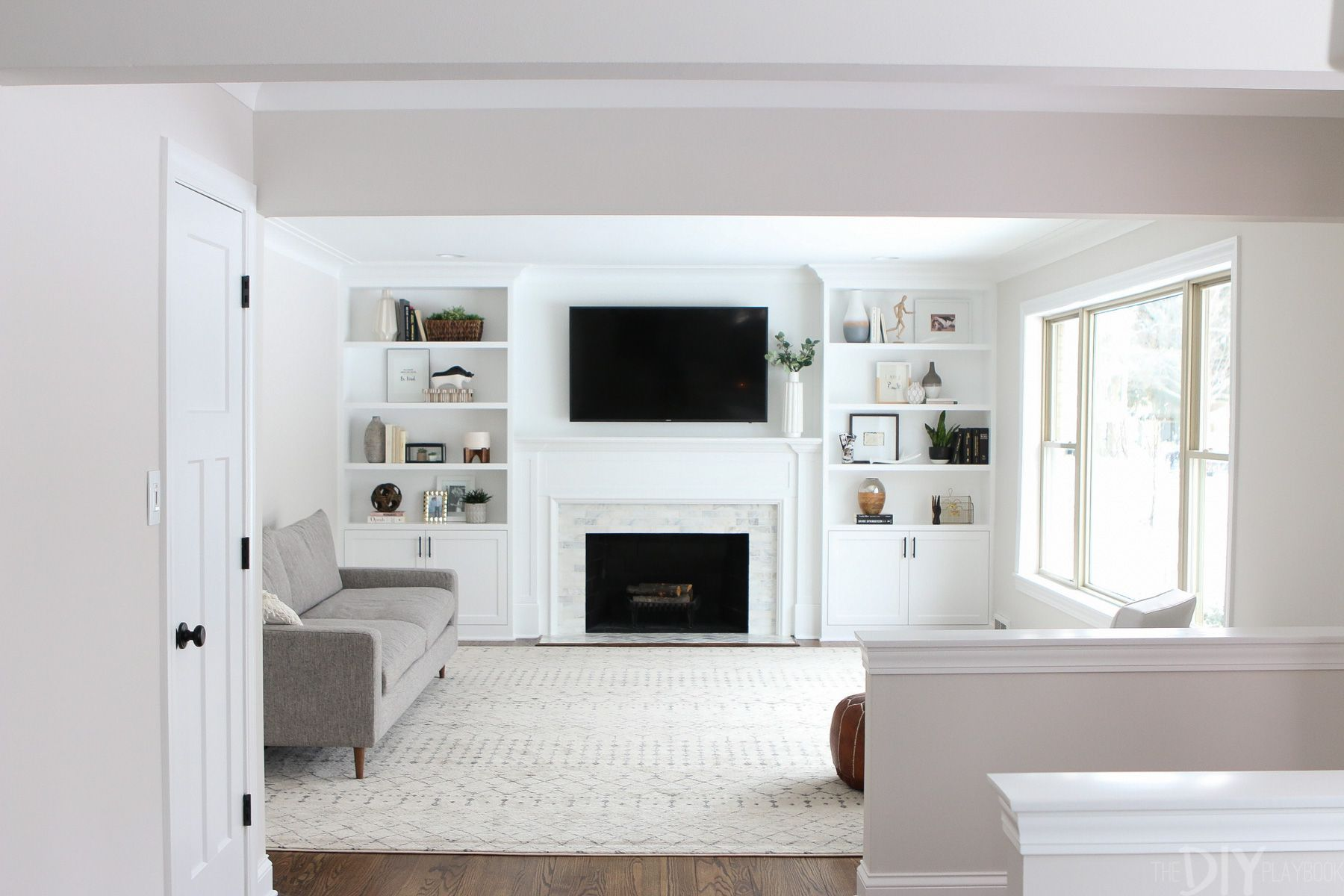 White Built Ins Around The Fireplace Before And After The Diy Playbook White Built Ins Fireplace Built Ins Living Room Remodel