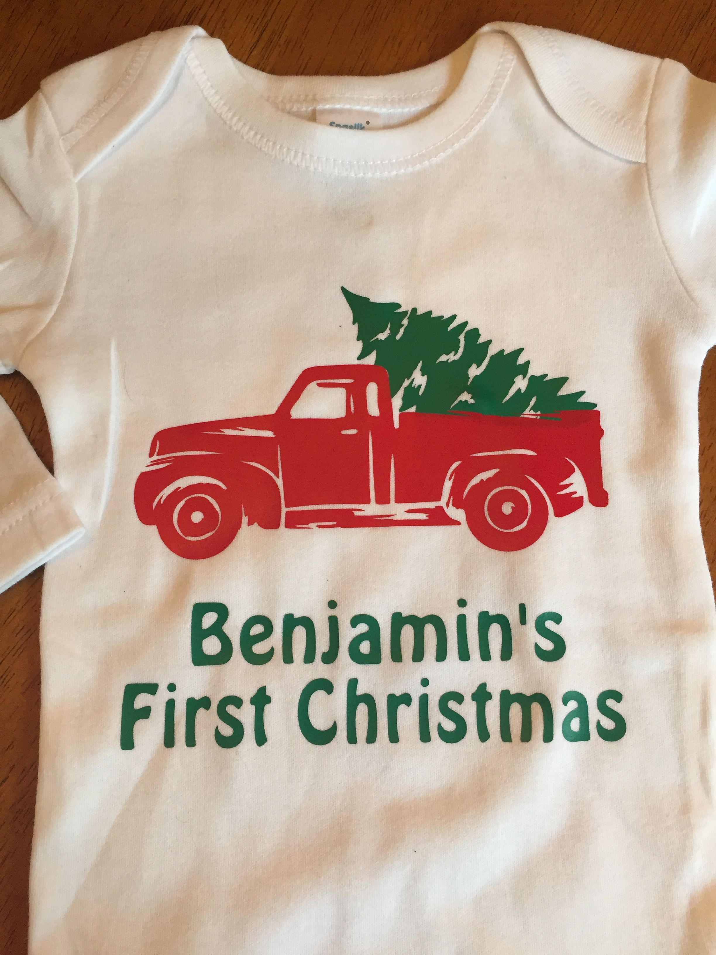 0997bd3fe Baby's First Christmas personalized onesie with green and red heat transfer  vinyl (htv). Siser Easyweed. Red truck.