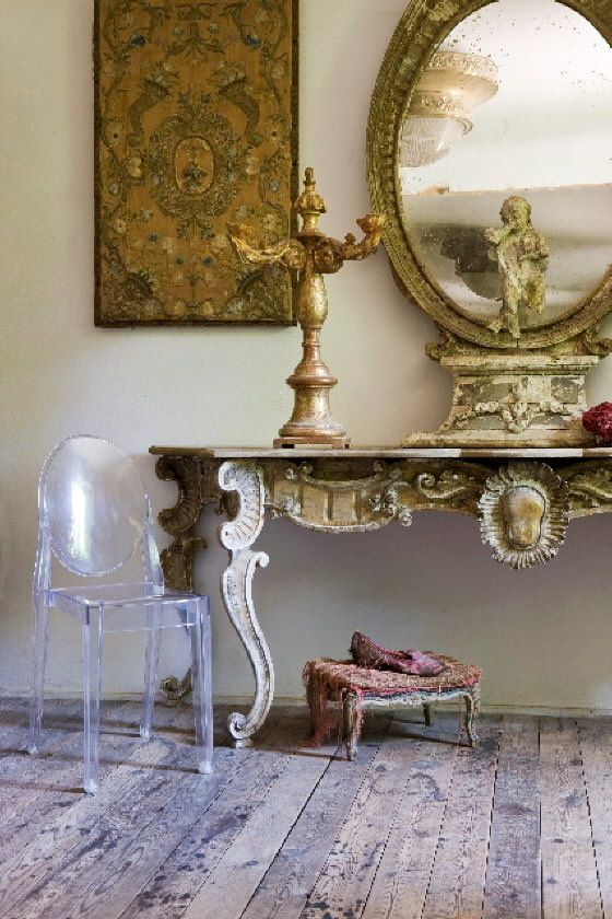 Phillipe Starck Ghost Chair, rustic wood floor, antique table and ...