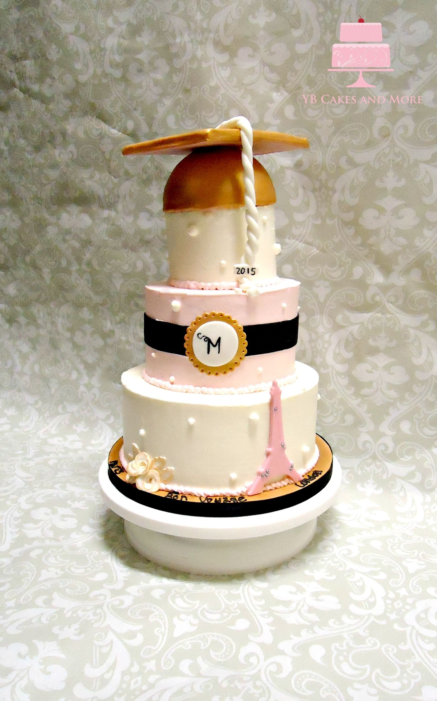 This is a 3 tier graduation cake with a Paris theme. buttercream with fondant appliques! Pink, gold, white and black make this cake so chic and slightly romantic. The roses were hand painted gold at the tips along with the rose leaves. By: YB Cakes and More
