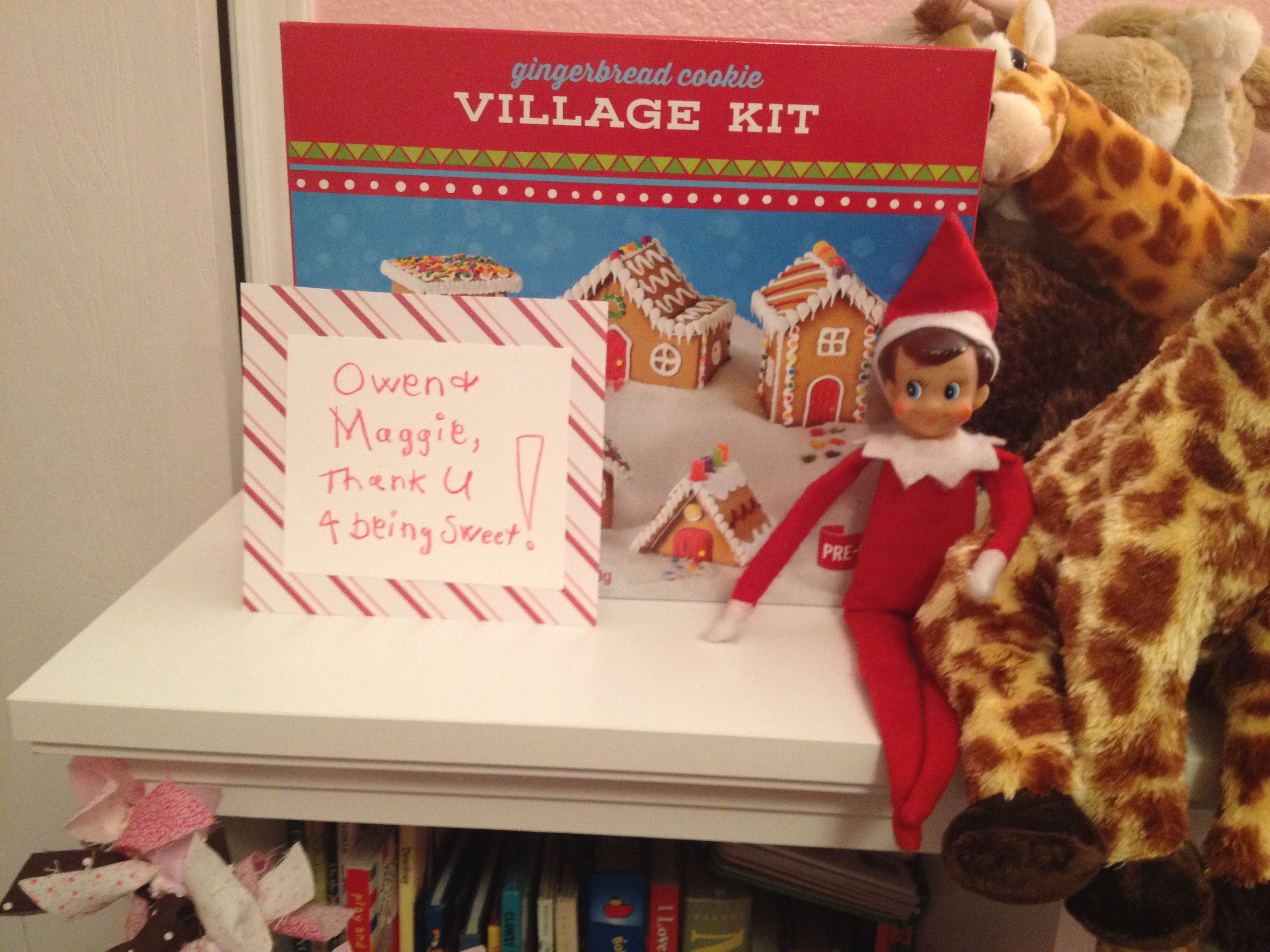 Elf on the Shelf brings the kids a gingerbread house kit for being good.