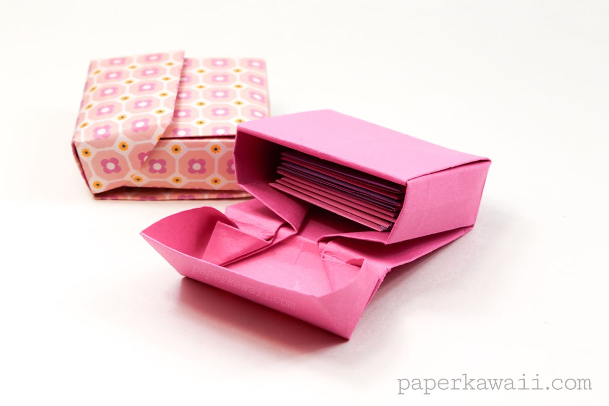 Learn how to make an origami flip top box. It looks a bit like a cigarette box, store cards and other stuff like crayons, pocky or candy in this box!