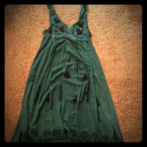 Hippie Dress One size fits most. This dress is so awesome. I like to wear a bandeau or black tank underneath and chacos on my feet with this dress. Has large pockets and flower design. Dresses Maxi