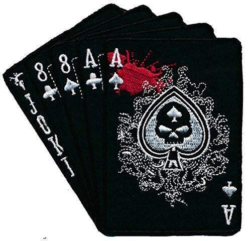 "Currently, the dead man's hand is described as a two-pair poker hand consisting of the black aces and black eights. Along with an unknown ""hole"" card, these wer"