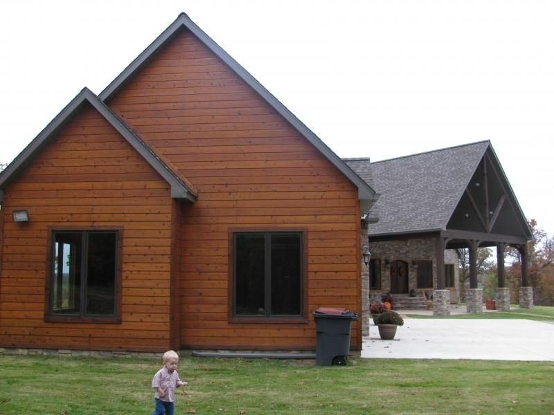 Faux cedar siding faux log cabin siding pinteres for Homes with wood siding