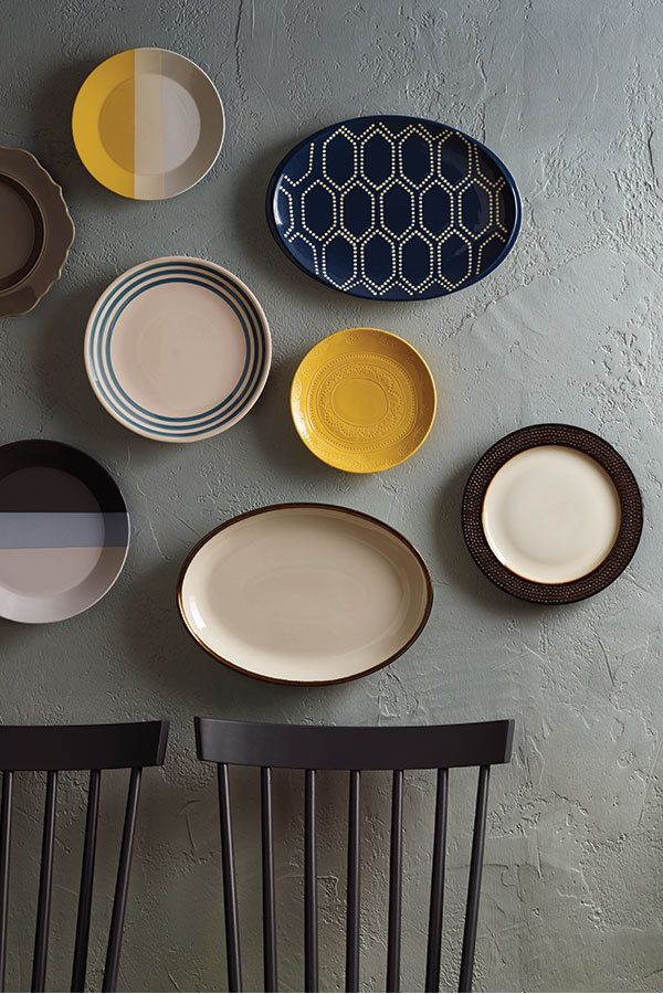 When plates feel almost too pretty to eat from turn them into wall art. Use wall hooks to hang a cluster of your favorite colorful, patterned plates of all sizes. #plates #collections #wallDisplay #art #wall