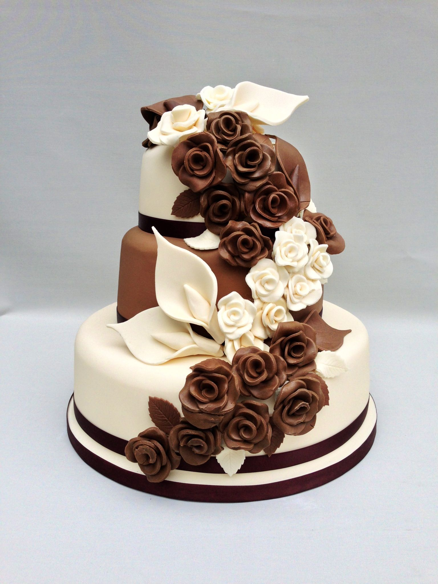 A milk and white chocolate cake decorated with chocolate flowers.                                                                                                                                                                                 More