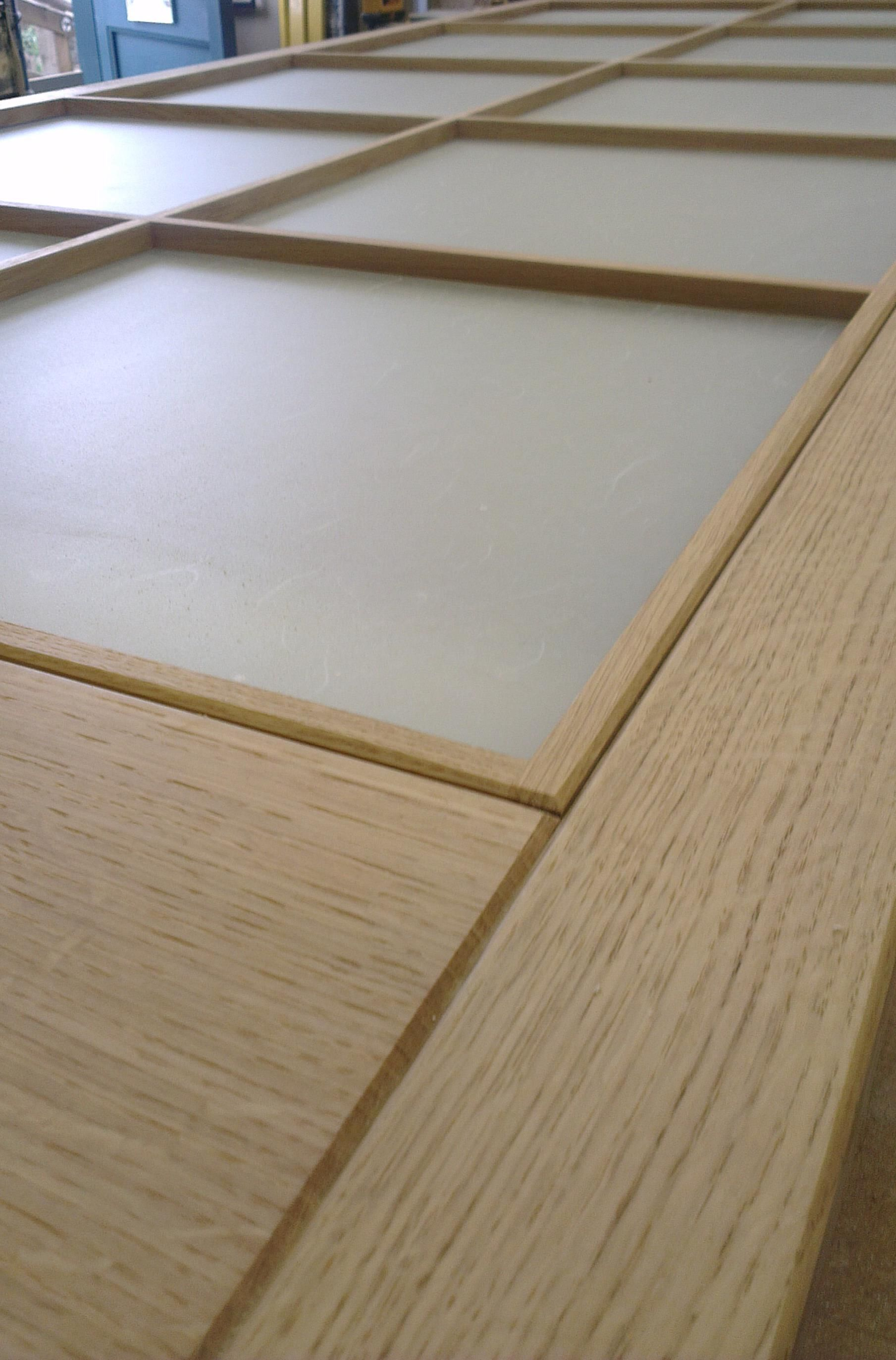Solid oak natural finish shoji screens with rice paper applied to