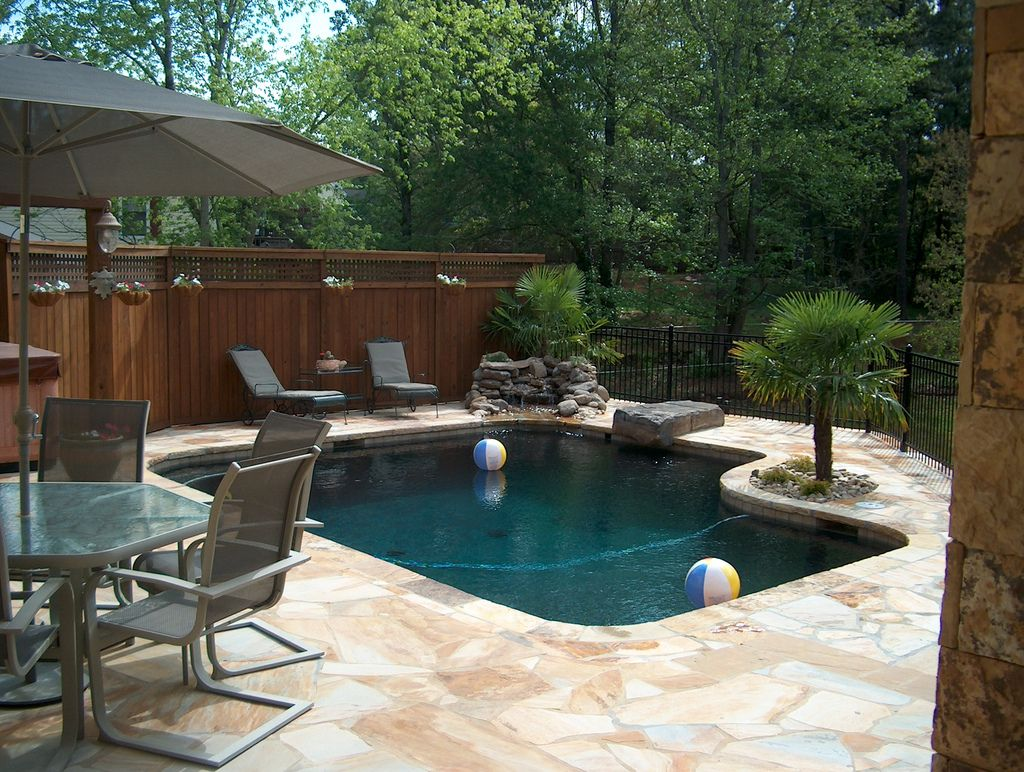 stone-swimming-pool-hardscape-landscape-atlanta  Small backyard
