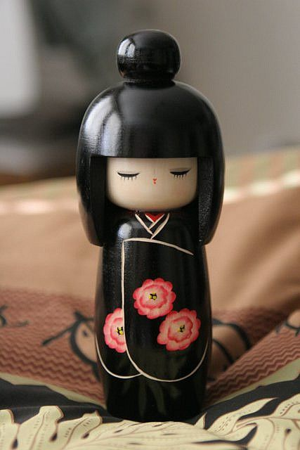 Kokeshi in black with pink floral                              …
