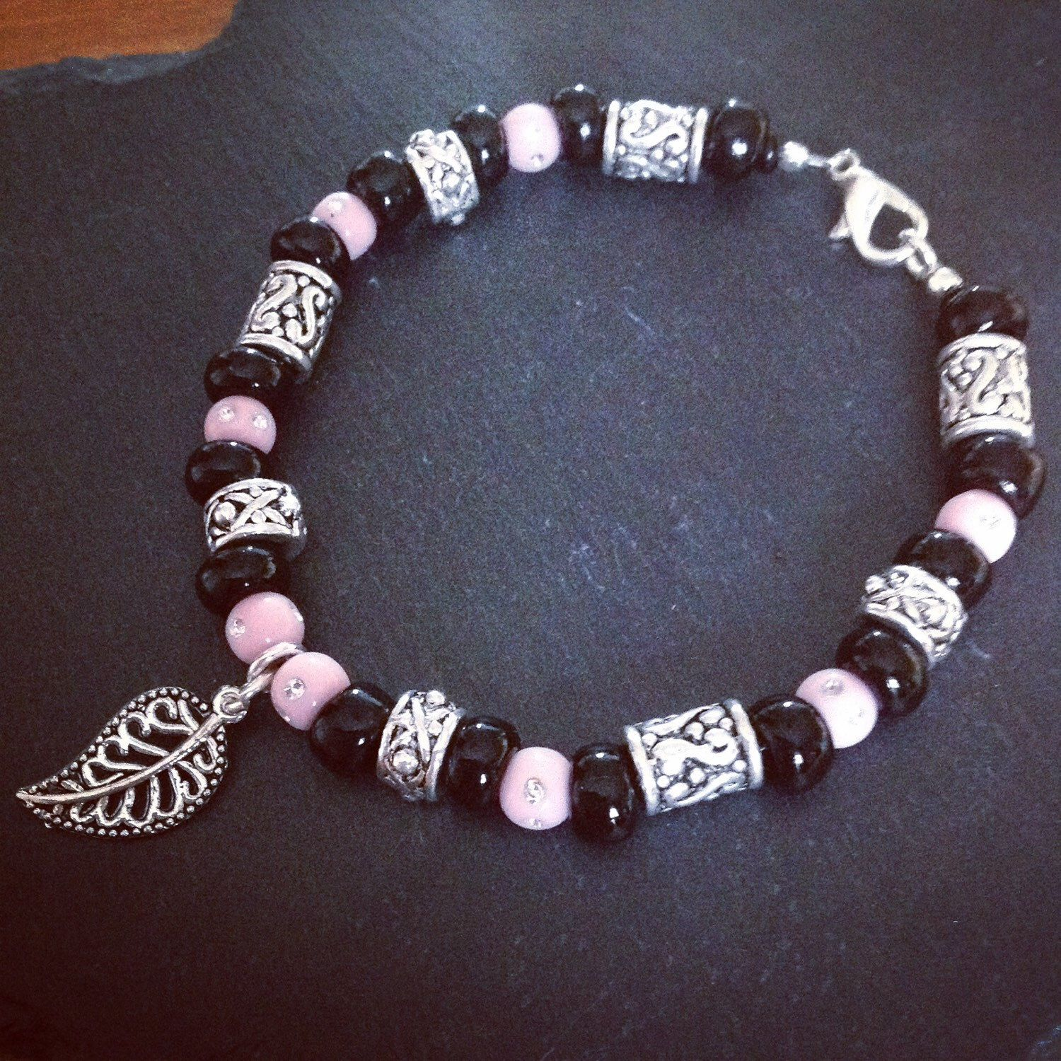 A personal favourite from my Etsy shop https://www.etsy.com/listing/233834012/pink-and-black-leaf-bracelet
