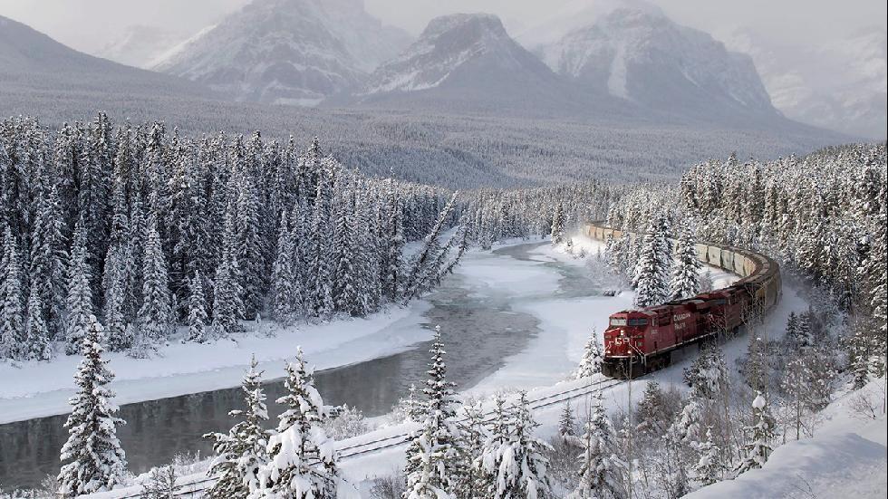 A Canadian Pacific freight train travels around Morant's Curve near Baker Creek, Alberta on Dec. 1, 2014. (AP Photo/The Canadian Press, Frank Gunn)