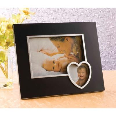 Keep friends and family close to your heart with this lovely frame. Holds 2 photos. Easel back. $9.50