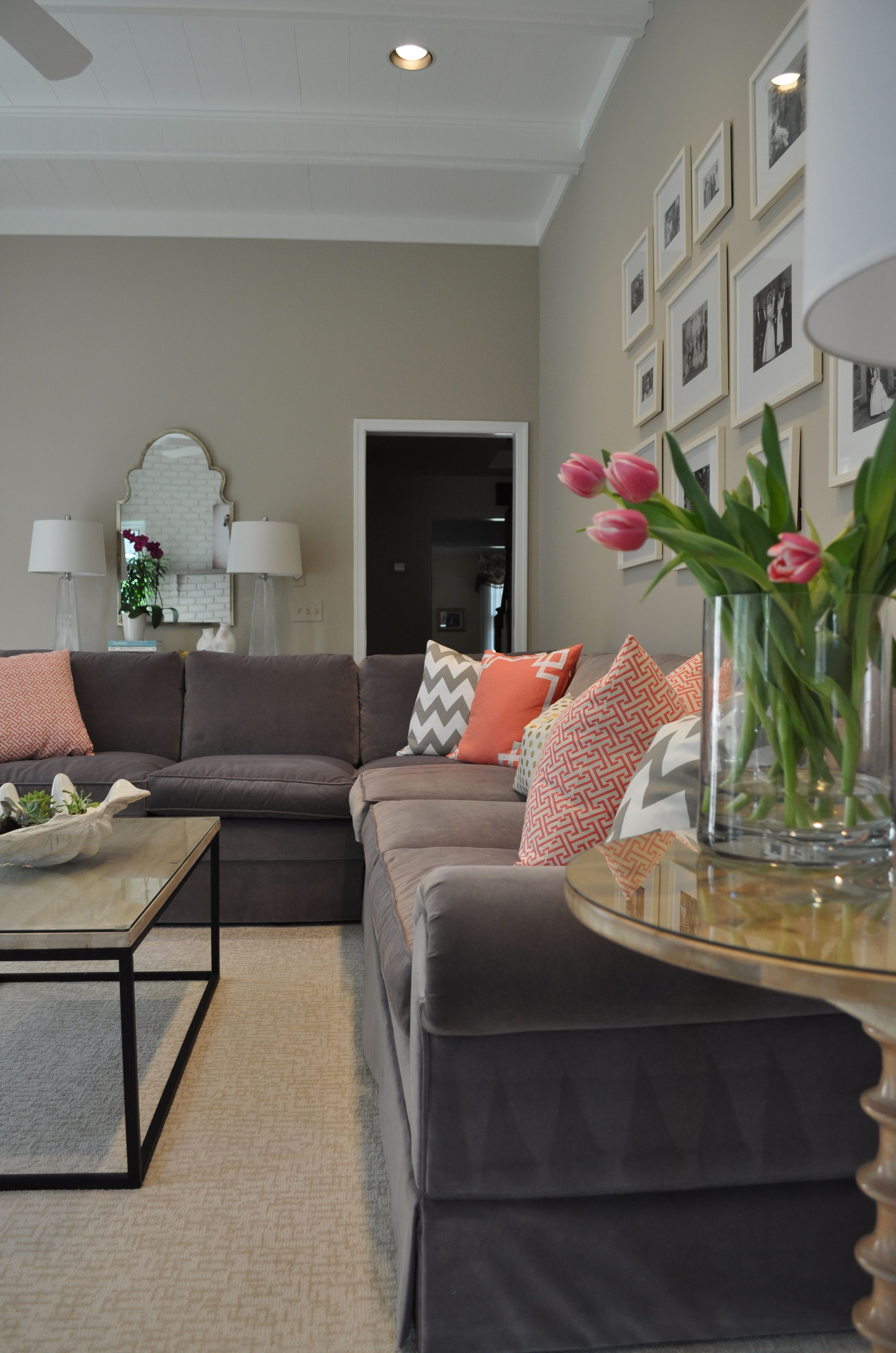 Neutral family room by JWS Interiors gray upholstered sectional
