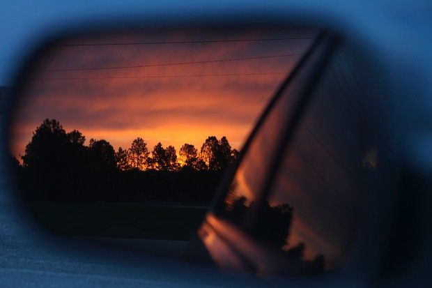 A sunset is reflected in a car's mirror off Highway 16. (Journal file) #SouthDakota #RapidCityJournal #Photos #Photography #Sunset