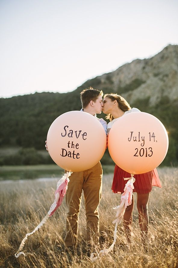Save the date idea: Giant balloons and fabric tassels.