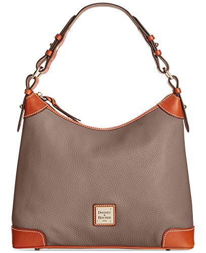 2744b501e2f7 Complement your everyday look with this chic Dooney Bourke bag. Hobo-style  handbag made of pebble grain leather. Contrast accents and stitch detail.