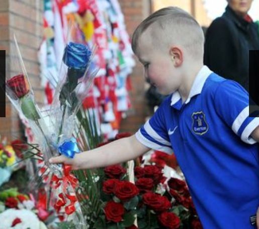 Four year old Everton fan Maison Daly places flowers at the tribute to the 96