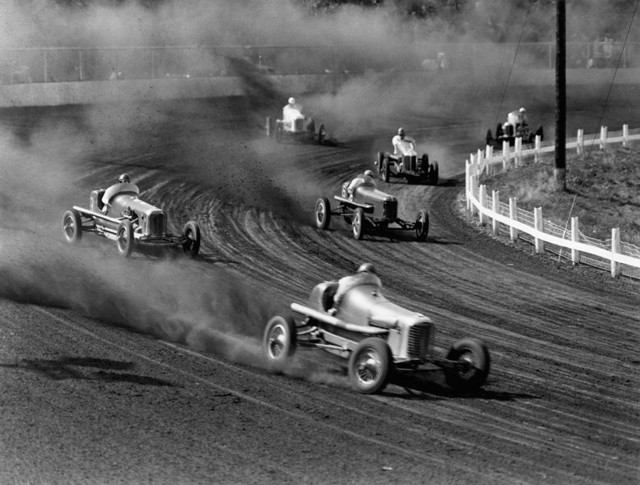 Race cars roar around the track at the Iowa State Fair in 1938 ...