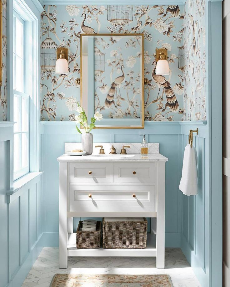 Pretty powder room with Chinoiserie wallpaper and blue