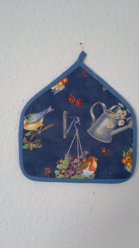 Pannenlap blauw met vogels en bloemen