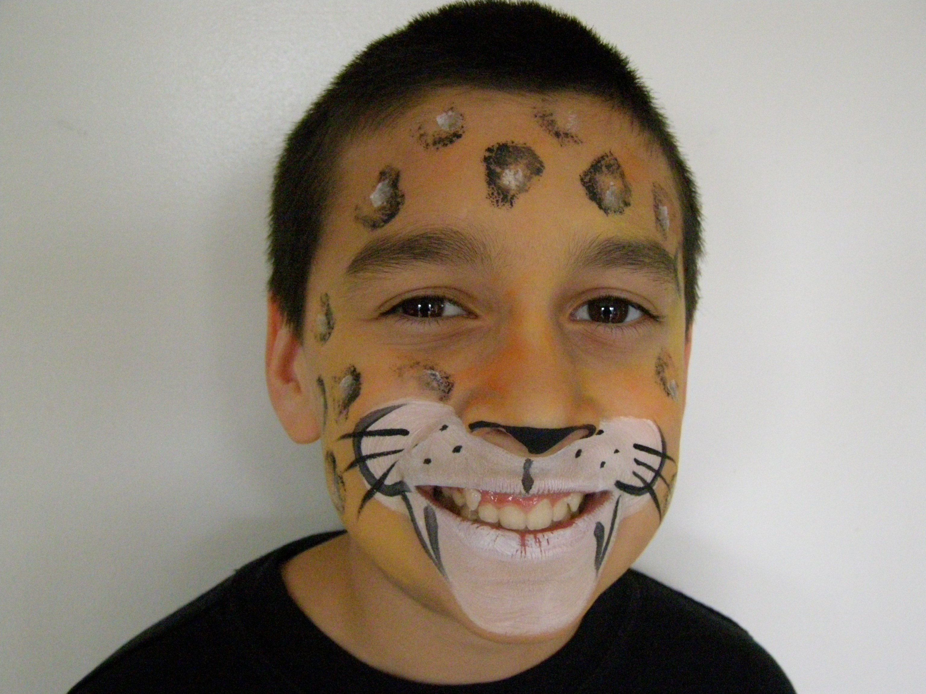Face painting cheetah or leopard first cover face with for Cheap face painting houston
