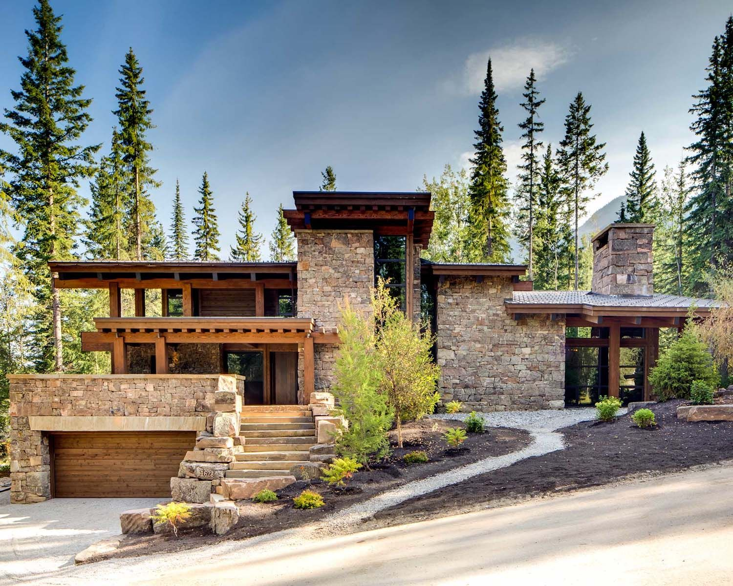 Rugged Mountain Ski Retreat In The Canadian Rockies House Exterior House Designs Exterior Hillside House